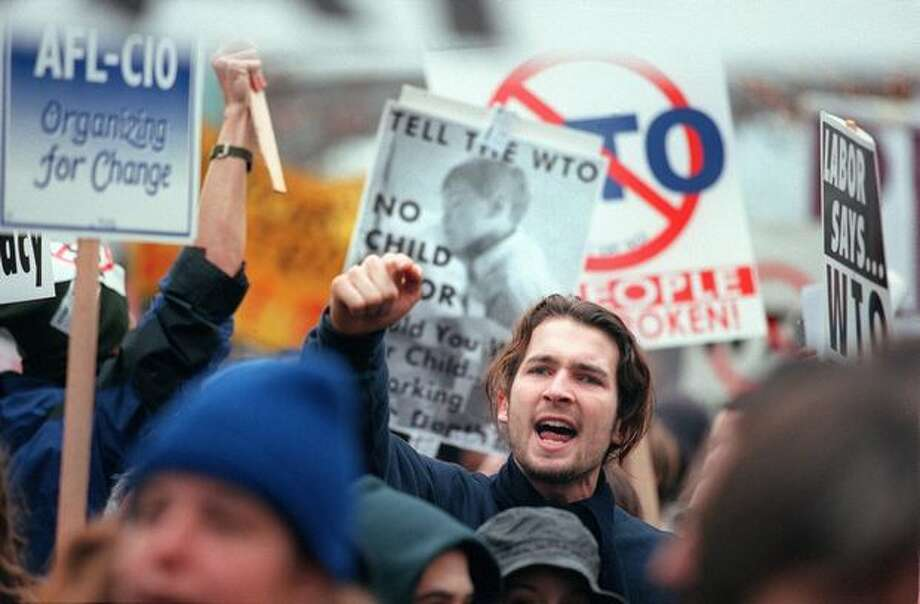 A union-led anti-WTO march makes its way through downtown Seattle on Dec. 3, 1999, as the WTO trade talks conclude. Photo: Seattle Post-Intelligencer