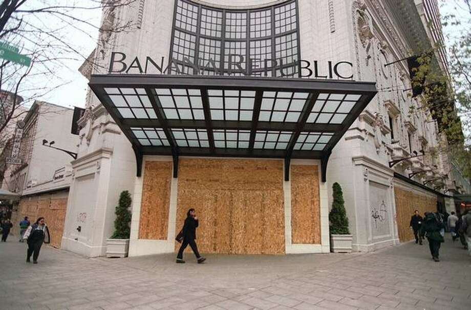 Banana Republic is boarded up on Dec. 1, 1999, after the business was attacked by protesters during the WTO gathering in Seattle. (Photo by Rick Giase) Photo: Seattle Post-Intelligencer