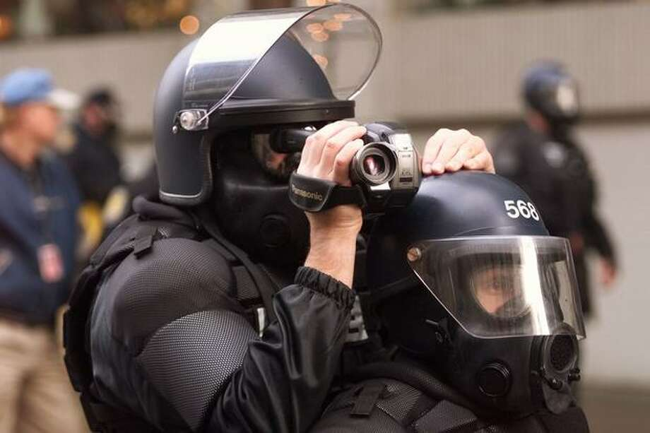Police officers video tape protesters on Nov. 30, 2009. (Photo by Mike Urban) Photo: Seattle Post-Intelligencer