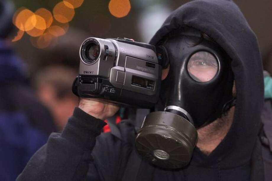 A protester videotapes police officers on Nov. 29, 2009. (Photo by Mike Urban) Photo: Seattle Post-Intelligencer