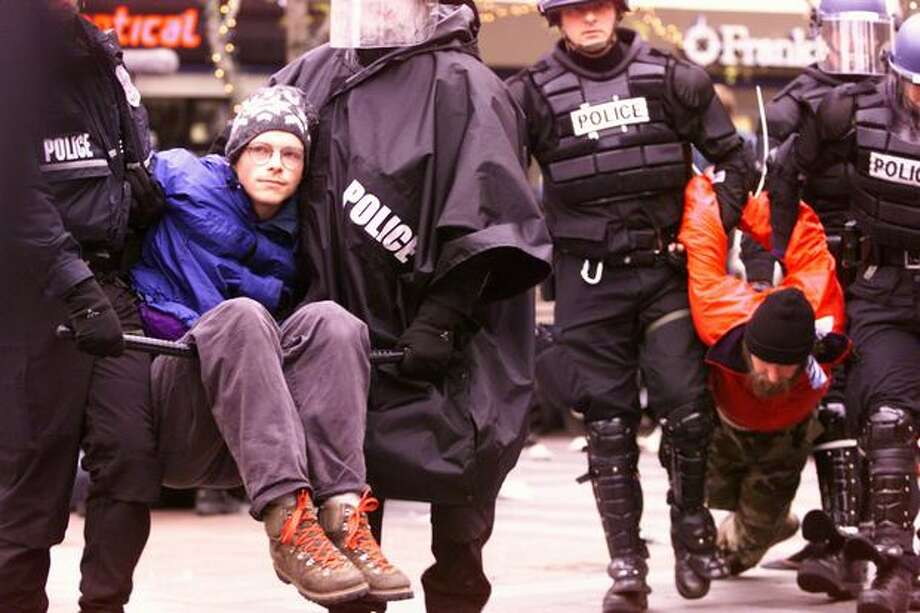 WTO protesters attempted a peaceful sit-down demonstration in Westlake Park on Dec. 1, 1999, but were hauled away by police. (Photo by Grant M. Haller) Photo: Seattle Post-Intelligencer