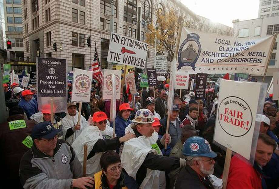 Members of labor unions march toward downtown Seattle on Nov. 30, 1999. (Photo by Rick Giase) Photo: Seattle Post-Intelligencer