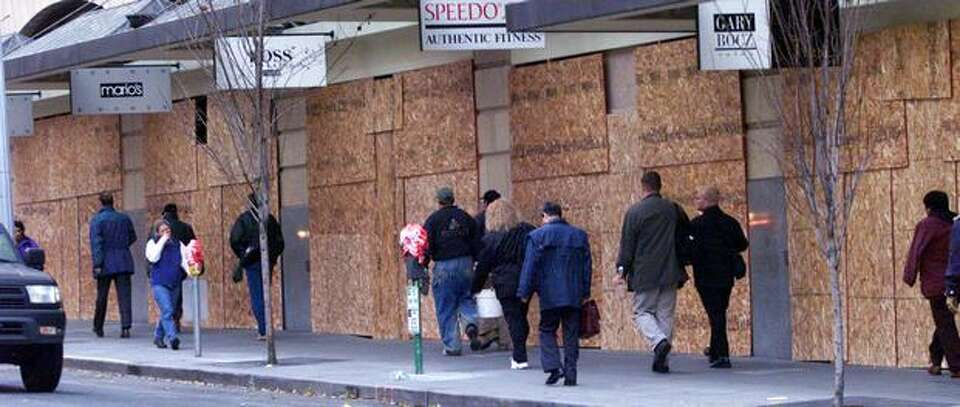 People were greeted with walls of plywood covering store windows on Sixth Avenue between Pike and Pi