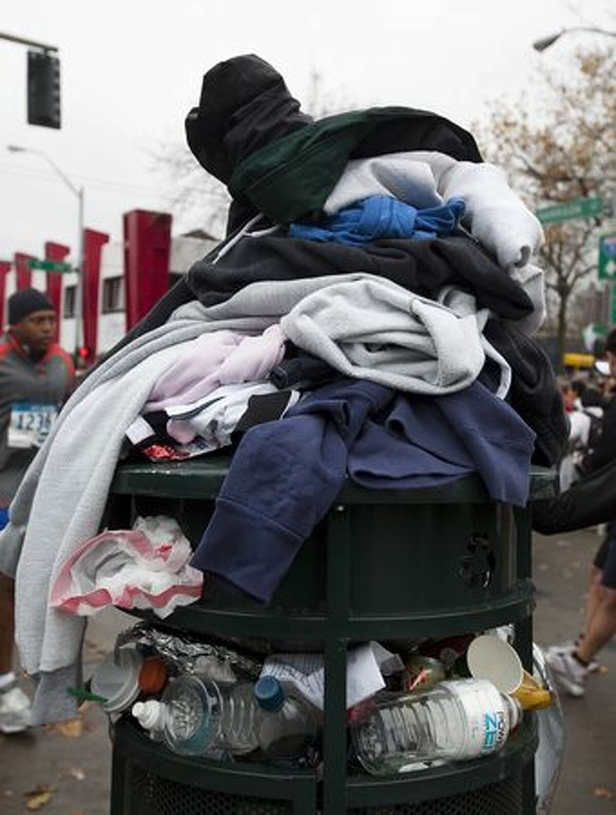 A pile of sweaters sit atop a garbage prior to the Seattle Marathon on Sunday.