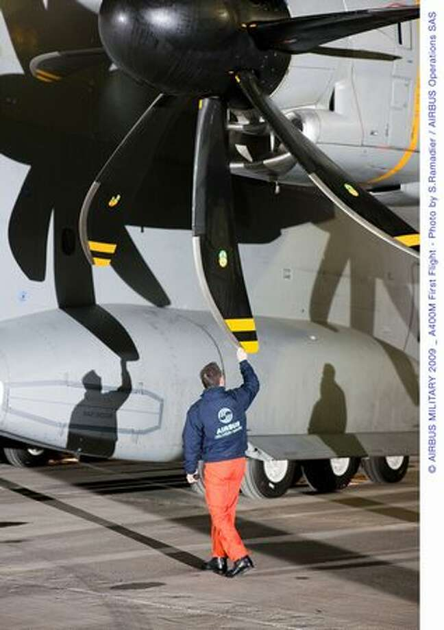 Flight crew inspects the Airbus A400M before takeoff on its first flight on Dec. 11, 2009 in Seville, Spain. (Airbus photo)