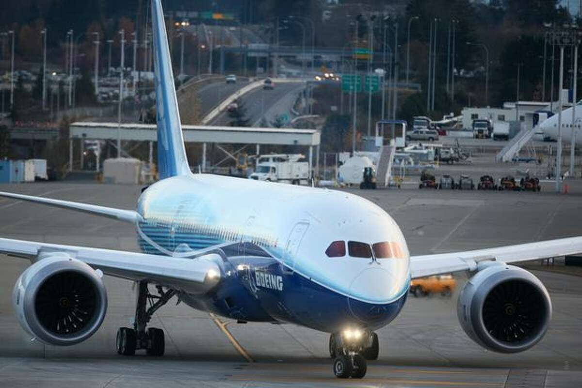 Boeing's 787 Dreamliner rolls down the taxiway during taxi tests on Saturday at Paine Field in Everett.
