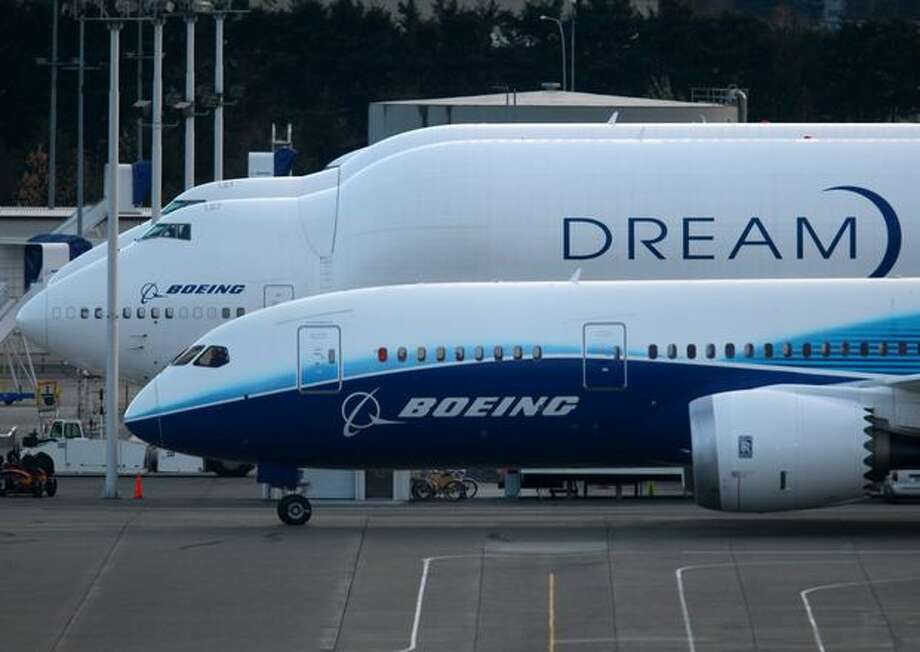 Boeing's 787 Dreamliner rolls past the Dreamlifter during taxi tests on Saturday at Paine Field in Everett. Photo: Joshua Trujillo, Seattlepi.com