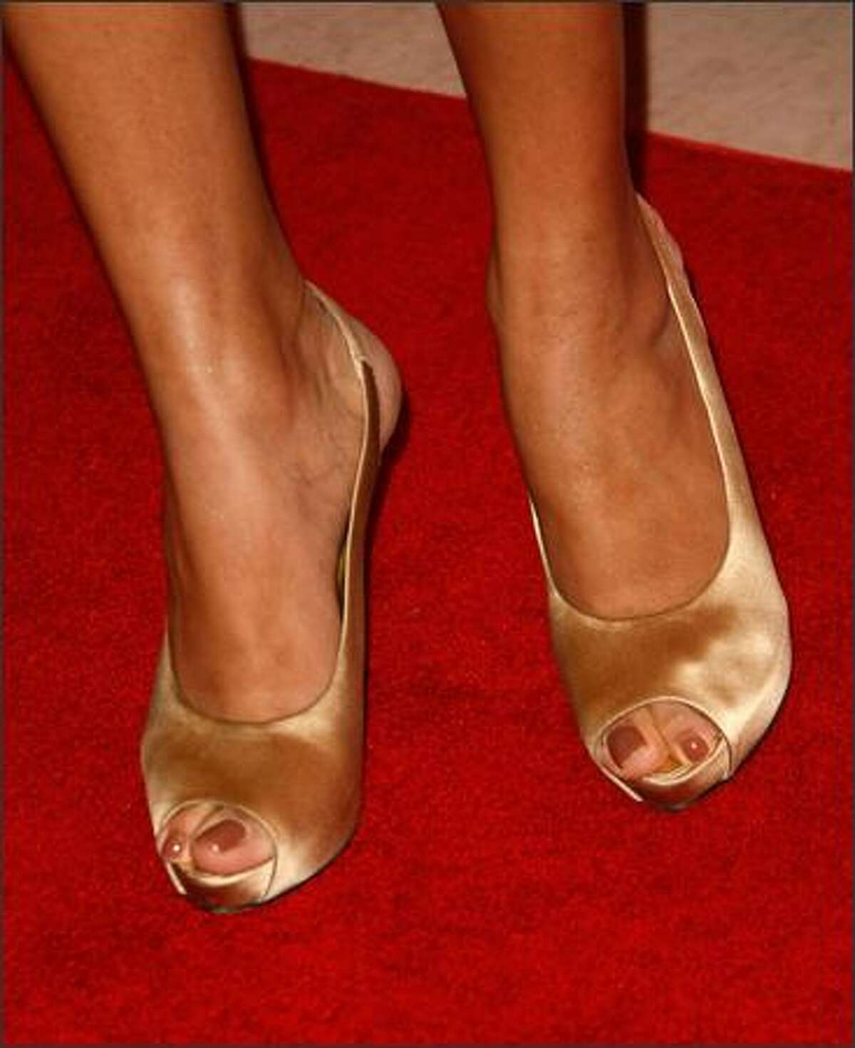 Actress Freida Pinto shows off her shoes.