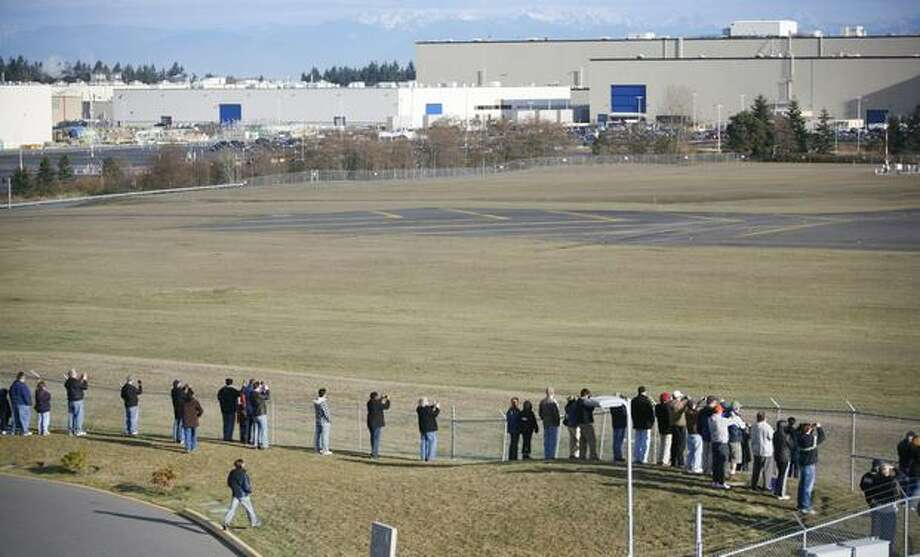 A crowd gathers to see Boeing's 787 Dreamliner perform taxi tests on Saturday at Paine Field in Everett. Photo: Joshua Trujillo, Seattlepi.com