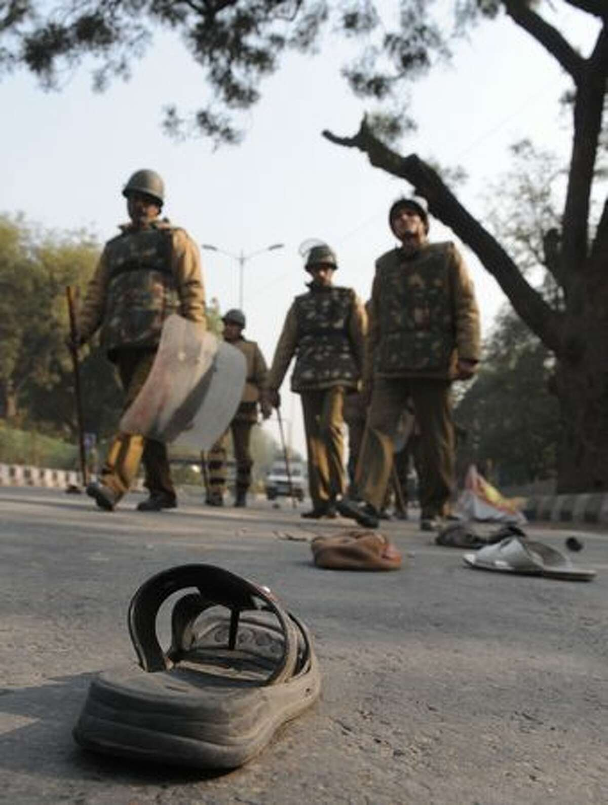 Footwear lie scattered on the road after a baton charge by Delhi Police during a protest against the demolition of an alleged illegally-built mosque in New Delhi on Wednesday. The