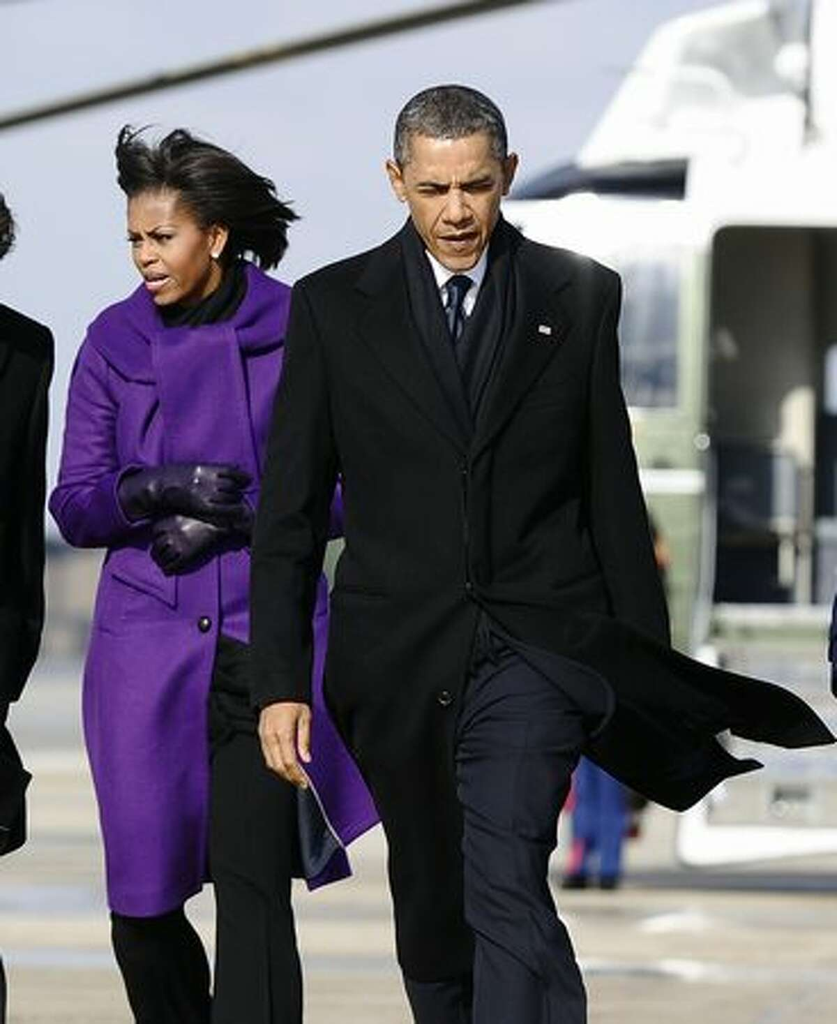 US President Barack Obama and First Lady Michelle Obama arrive to board Air Force One at the Andrews Air Force Base in Maryland on Wednesday to leave for Tucson, Arizona, to attend the memorial event