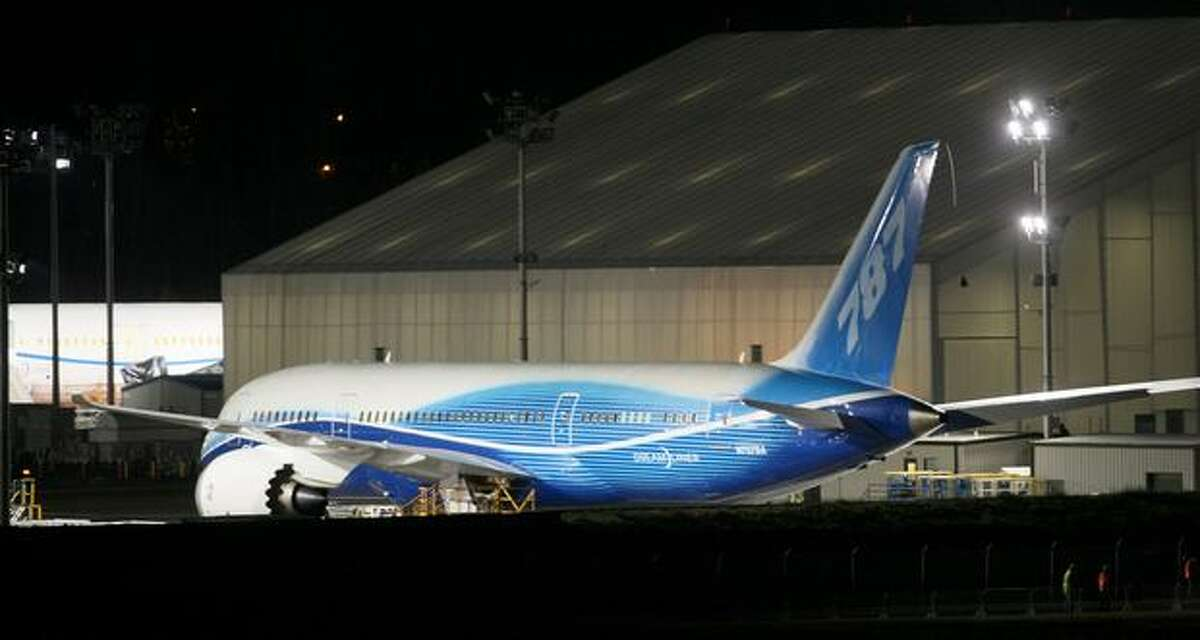 Boeing's 787 Dreamliner sits in a holding lot before making its first flight at Paine Field in Everett on Tuesday.
