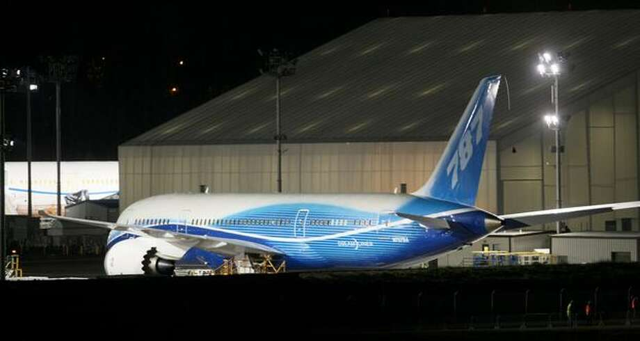 Boeing's 787 Dreamliner sits in a holding lot before making its first flight at Paine Field in Everett on Tuesday. Photo: Thom Weinstein, Seattlepi.com