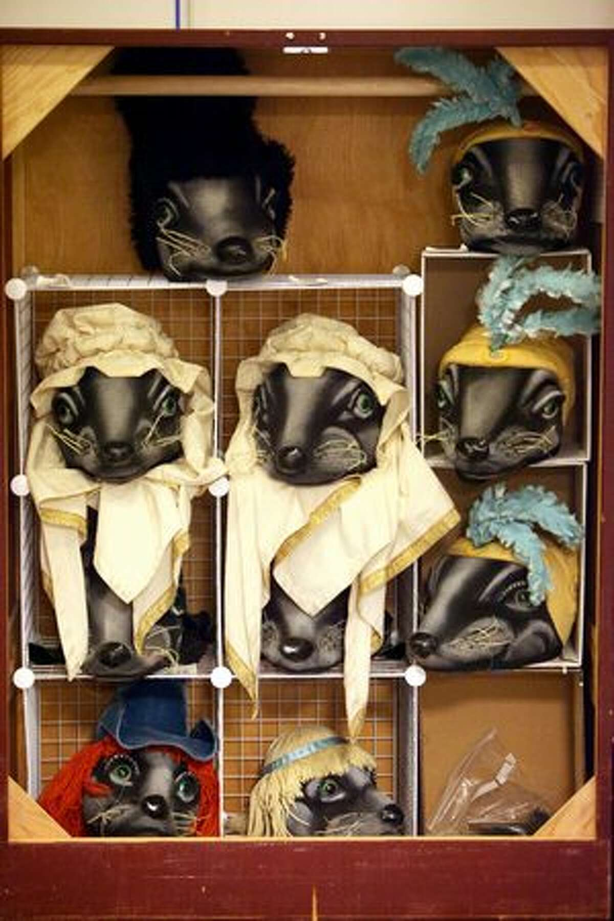 """""""Mouse"""" costumes are stored on a rack during intermission."""