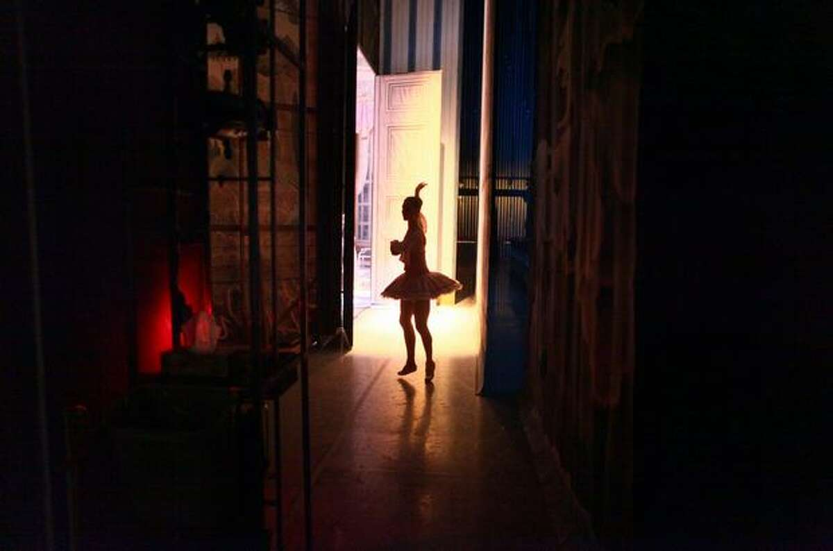 A dancer prepares backstage.