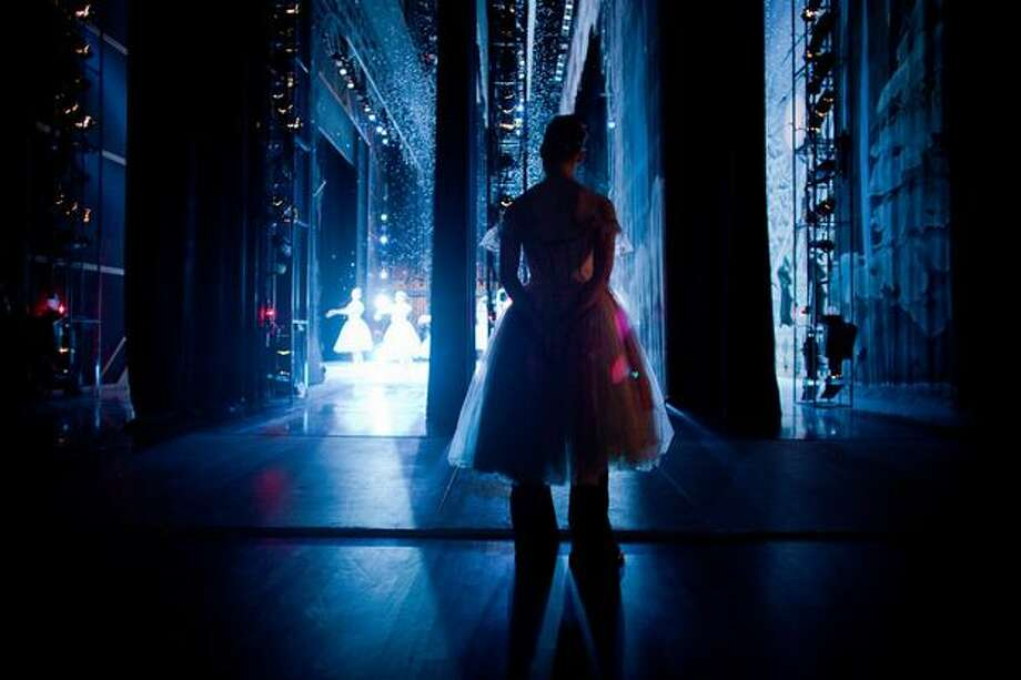 A dancer watches the snow scene from backstage. Photo: Joshua Trujillo, Seattlepi.com