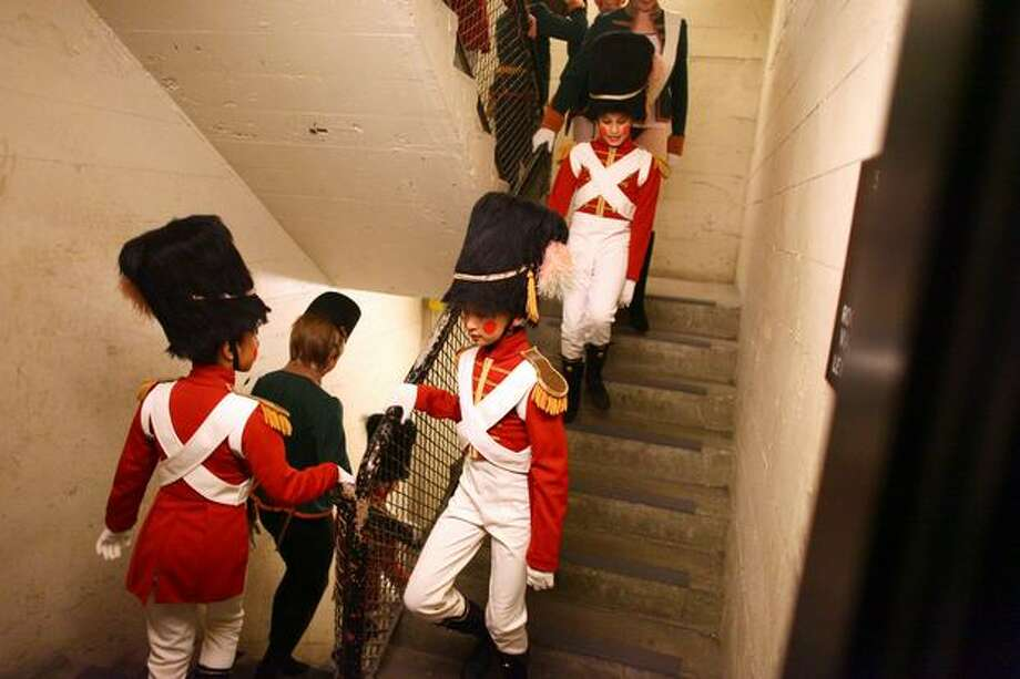 """Soldiers"" march down a stairwell from their dressing room. Photo: Joshua Trujillo, Seattlepi.com"