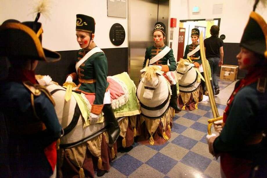 """Soldiers"" and their horses wait in a hallway to take the stage. Photo: Joshua Trujillo, Seattlepi.com"