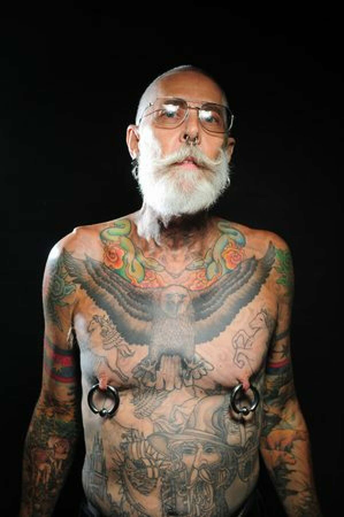 Dan Adcock poses for a portrait during the first day of the Seattle Tattoo Expo at Seattle Center on Aug. 7, 2009.