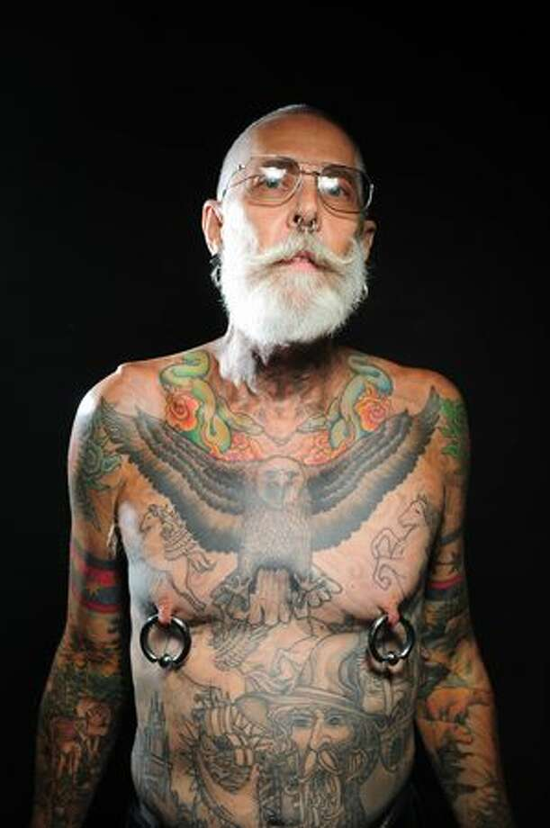 Dan Adcock poses for a portrait during the first day of the Seattle Tattoo Expo at Seattle Center on Aug. 7, 2009. Photo: Daniel Berman, Seattlepi.com