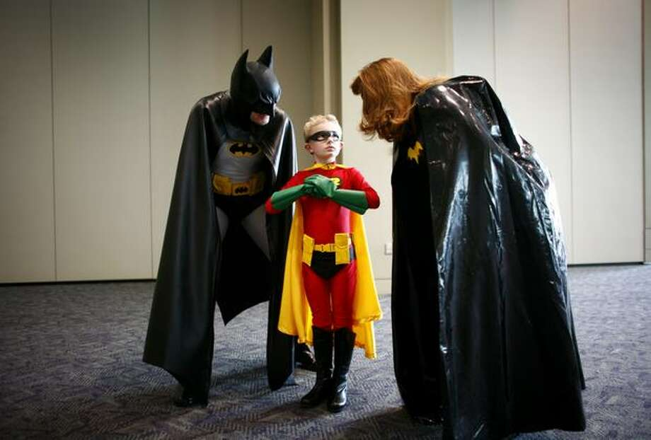 Mark VanDoornik, 7, dressed as Robin, talks to his dad Don, Batman, and mom Mary Anne, Batwoman, at the Emerald City ComiCon on April 4, 2009 at the Washington State Convention & Trade Center in Seattle. Photo: Joshua Trujillo, Seattlepi.com