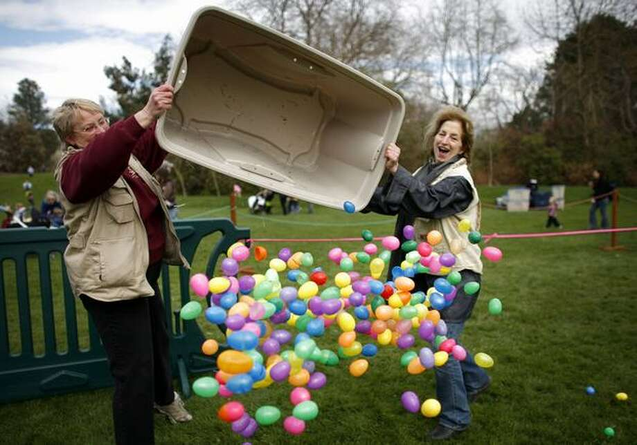 Annette Rothe, left, and Barb Scharman have almost as much fun as the kids as they spread plastic Easter eggs on the Woodland Park Zoo's North Meadow during the Bunny Bounce on April 11, 2009 in Seattle. The event included an Easter egg hunt and other activities for kids. Photo: Joshua Trujillo, Seattlepi.com