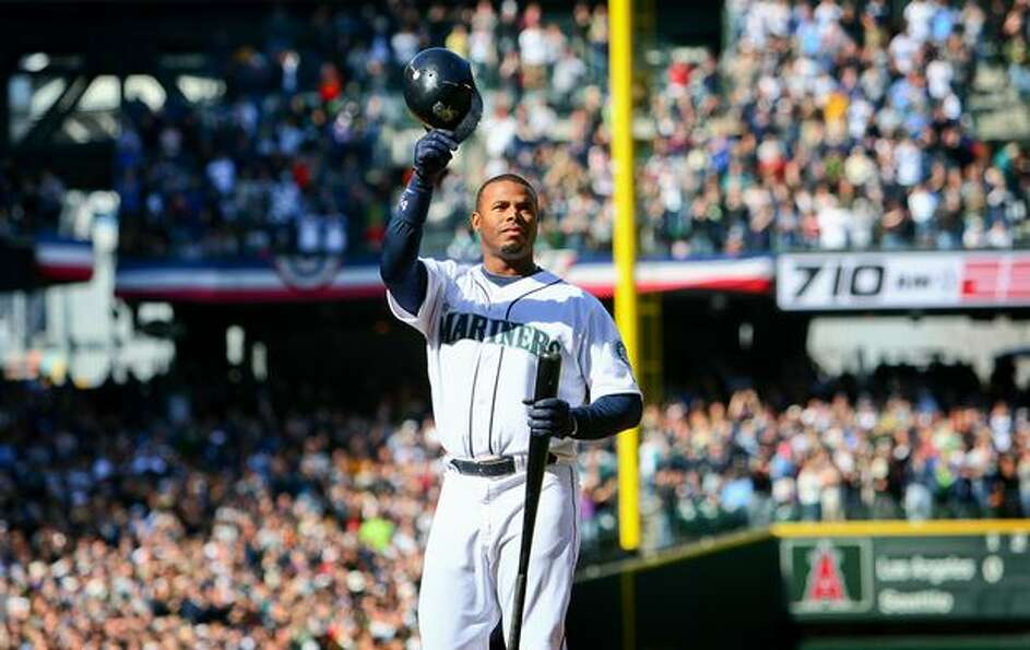 Ken Griffey Jr. tips his helmet to the screaming fans in Safeco Field as he steps to the plate for t
