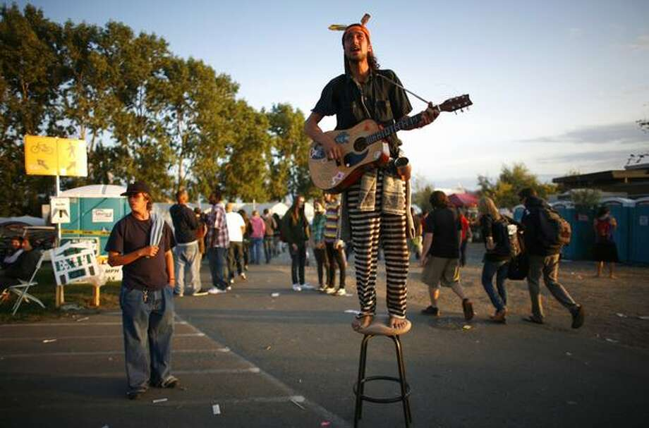 Adam No Left Turns stands atop a chair and belts out a tune for people during Hempfest at Myrtle Edwards and Elliott Bay parks in Seattle on Aug. 15, 2009. Photo: Joshua Trujillo, Seattlepi.com