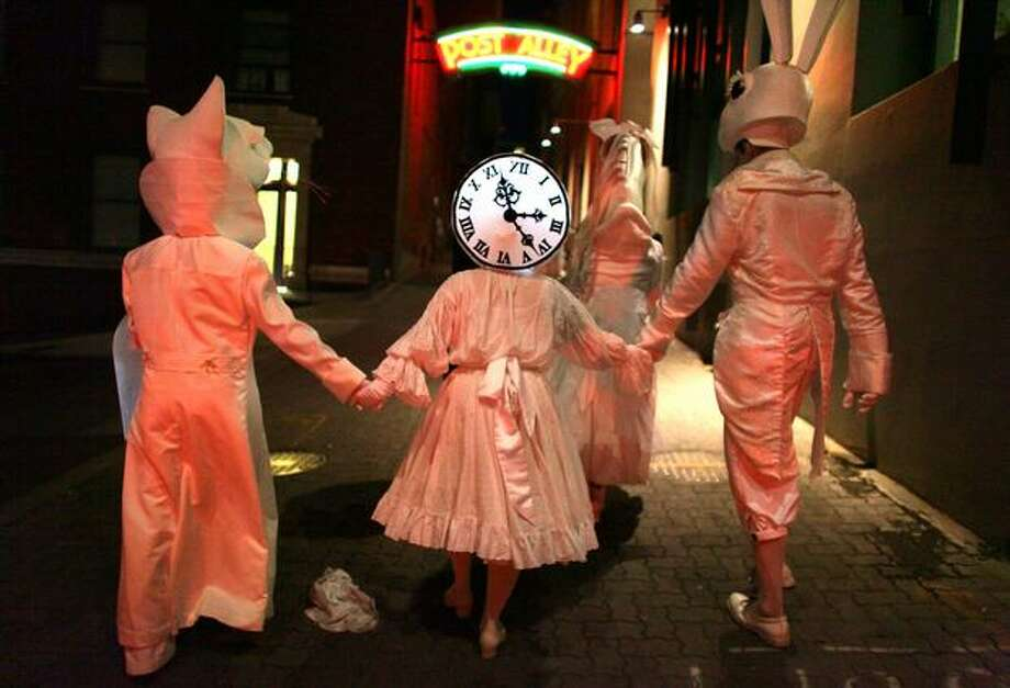 Performers in Lullaby Moon make their way along Post Alley while celebrating the new moon in the streets of downtown Seattle on Aug. 20, 2009. Photo: Joshua Trujillo, Seattlepi.com