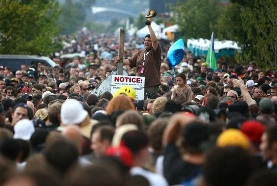 A worker tries to guide human traffic as the crowd bottlenecks near the south entrance during Hempfest at Myrtle Edwards and Elliot Bay parks in Seattle on Aug. 15, 2009. Photo: Joshua Trujillo, Seattlepi.com