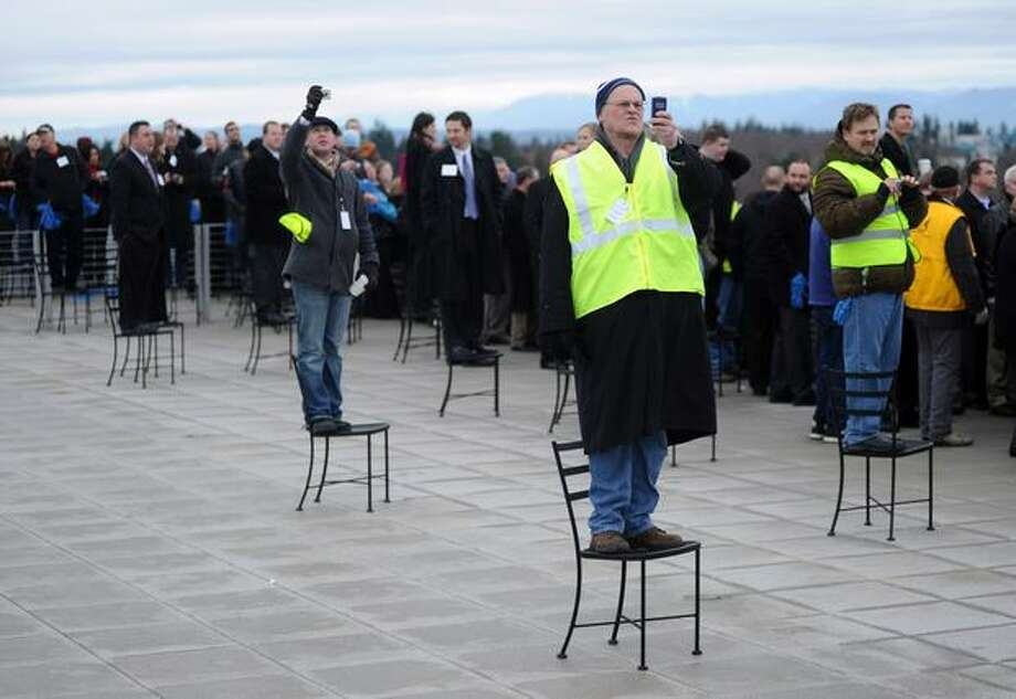 Spectators watch from the Stratodeck of the Future of Flight Aviation Center as Boeing's 787 Dreamliner taxis down the runway to make its first flight at Paine Field in Everett on Dec. 15, 2009. Photo: Thom Weinstein, Seattlepi.com