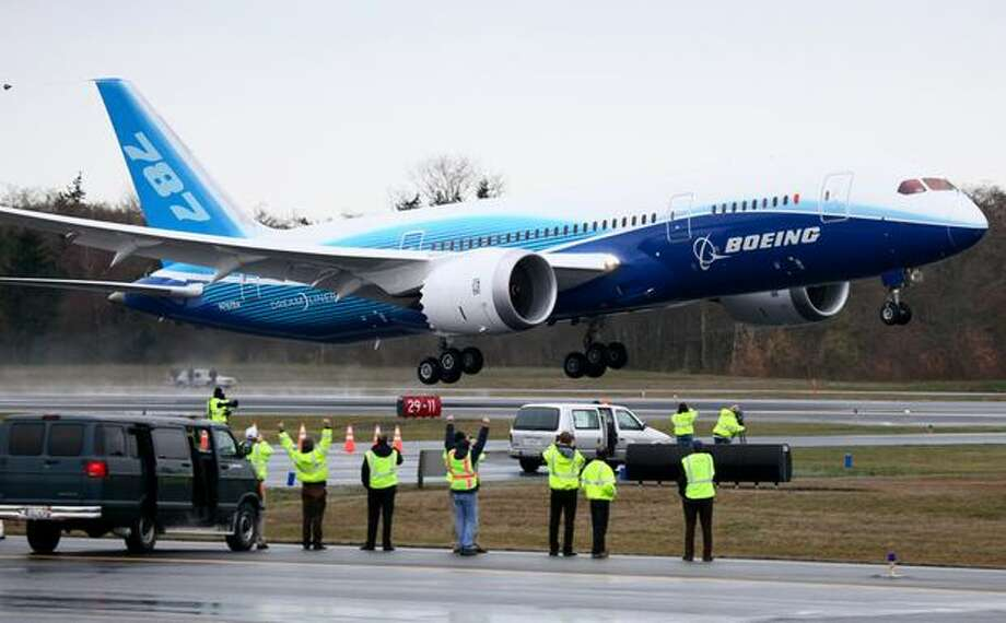 Boeing's 787 Dreamliner takes off on its maiden flight from Everett's Paine Field on Dec. 15, 2009. The plane, made largely of composite materials, took off on its first test flight after years of delays. Photo: Joshua Trujillo, Seattlepi.com