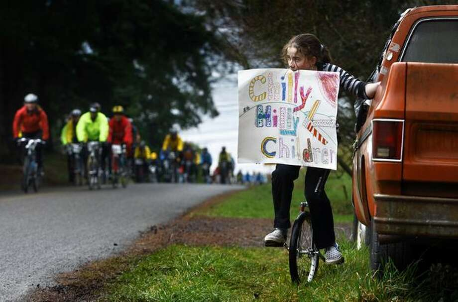 Maddie Rogers, 12, puts on a show in order to solicit business for the snacks and cider stand she was running with her friends during the Chilly Hilly bicycle ride around Bainbridge Island on Feb. 22, 2009. Photo: Andy Rogers, Seattle Post-Intelligencer