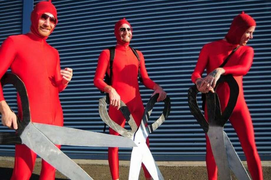 Left to right, Matt Kramer, Rob van Oss, and Joshua Freer pose as The Big Lebowski characters the nihilists before the start of Lebowski Fest at Acme Bowl in Tukwila on July 21, 2009. Photo: Daniel Berman, Seattlepi.com