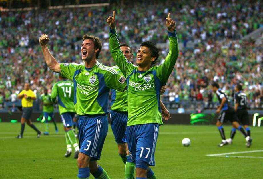 Seattle Sounders player Brad Evans (3) celebrates with teammate Fredy Montero (17) after Montero's second-half goal against the San Jose Earthquakes on June 13, 2009 at Qwest Field in Seattle. Photo: Joshua Trujillo, Seattlepi.com