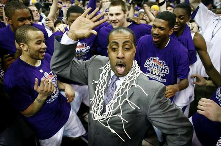 University of Washington men's basketball coach Lorenzo Romar dances with his players after the team secured the Pac-10 Conference title with a win over Washington State on March 7, 2009 at Hec Ed Pavilion in Seattle. It was the Huskies' first outright conference championship in 56 years. Photo: Joshua Trujillo, Seattlepi.com