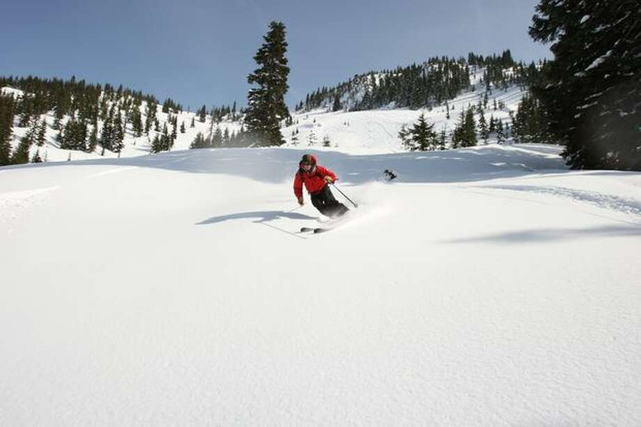 Chris Olson, from Snohomish, a guide, skis untouched powder in the backcountry on a trip with Cascade Power Cats near Stevens Pass on March 13, 2009. Photo: Mike Kane, Seattle Post-Intelligencer