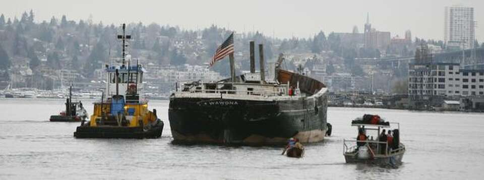 The historic schooner Wawona is towed across Lake Union in Seattle on its last voyage to Lake Union