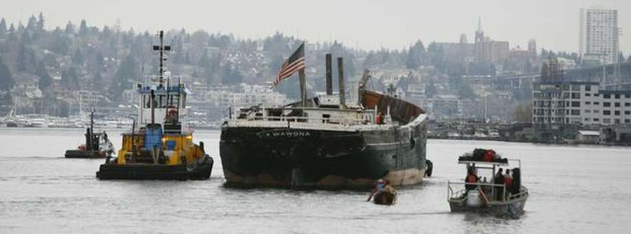 The historic schooner Wawona is towed across Lake Union in Seattle on its last voyage to Lake Union Drydock Company on March 4, 2009. The schooner Wawona was built in 1897 in California to haul lumber from Washington ports to California. She became a fishing schooner in 1914, working in the Bering Sea. In 1947, she was an Army barge and hauled lumber to the Boeing airplane factory for building military aircraft for World War II. Photo: Paul Joseph Brown, Seattle Post-Intelligencer