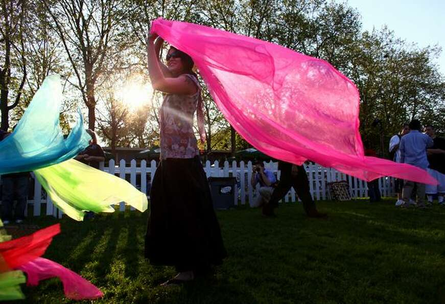 Phyllis Spencer of Seattle dances with colorful cloth during the 2009 Folklife Festival on May 22, 2