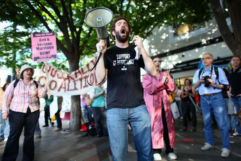 Jason Farbman gets the crowd excited with chants on May 26, 2009, at Westlake Park in Seattle during a rally against the court ruling in California that upheld Proposition 8, banning gay marriage in California. Photo: Joshua Trujillo, Seattlepi.com