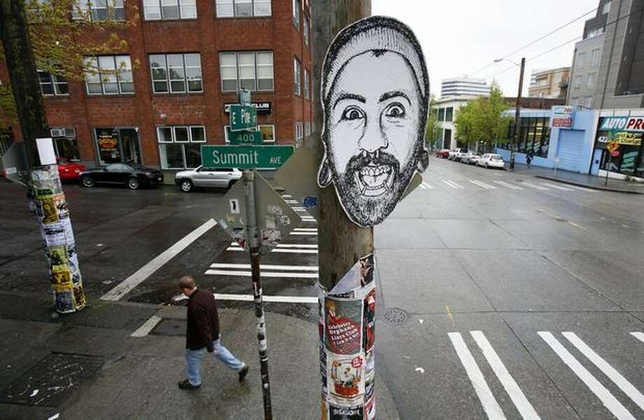 A face is stuck on a telephone pole at the intersection of Summit Avenue and East Pine Street on May 13, 2009 in Seattle. City leaders met to figure out how to maintain the character of the neighborhood. Photo: Joshua Trujillo, Seattlepi.com