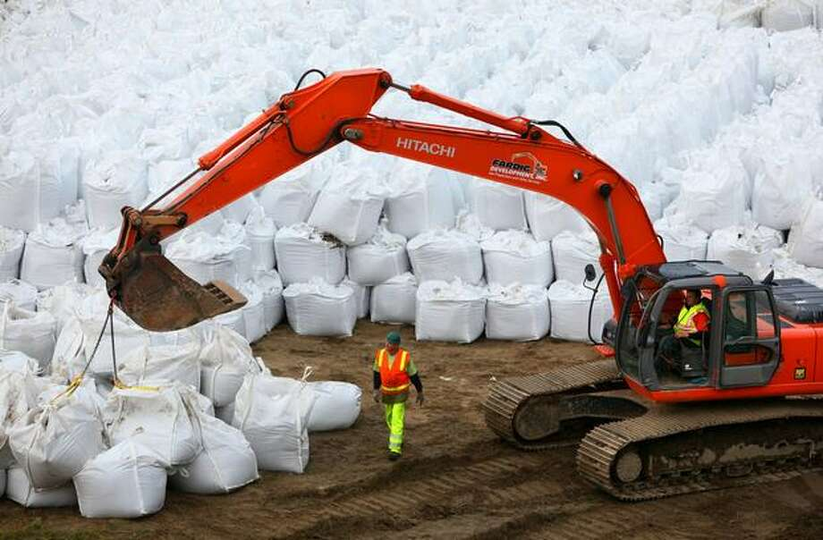 Contractors prepare a mountain of large sand bags to reinforce levees along the Green River in Kent on Oct. 2, 2009, as the community prepares for possible flooding this fall. Damage to a dam upstream may cause the U.S. Army Corp of Engineers to release large amounts of water into the populated valley. Photo: Joshua Trujillo, Seattlepi.com
