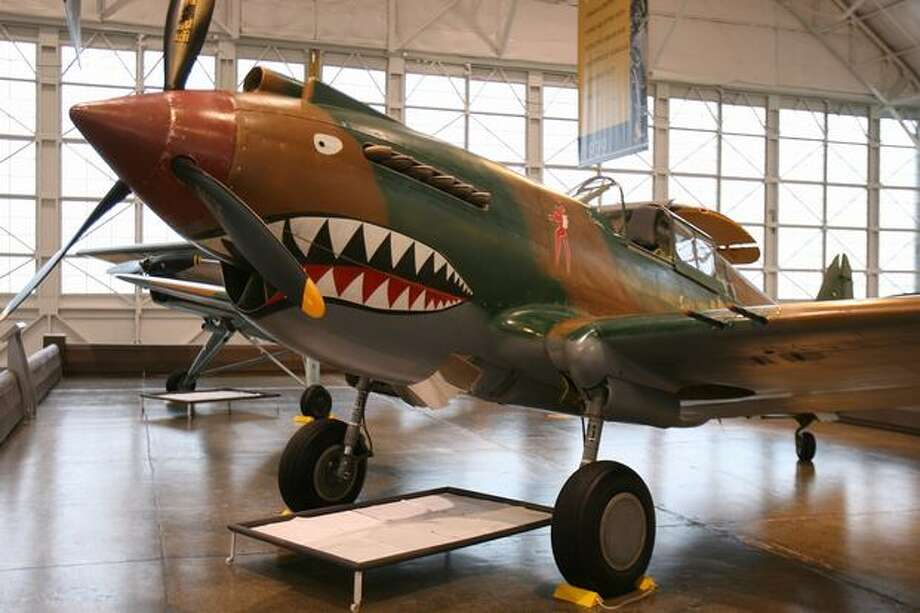 Flying Heritage Collection: Curtiss P-40 TomahawkThis debuted at the start of WWII and, while not the most-advanced fighter of the war, was cheap to make, with high-speed agility at lower altitudes, dependability and simplicity. This one sold to the British and then given in 1941 to the Soviet Union, which used it in defense of Murmansk. It managed a belly landing near there after having its oil tank punctured by enemy fire on Sept. 27, 1942 and was abandoned and later found thanks to satellite photos. It is the world's only remaining P-40C in flying condition and has been repainted, using movie paint, in the colors of the Flying Tigers – the 1st American Volunteer Group of the Chinese Air Force – which used the P-40. Photo: Aubrey Cohen, Seattlepi.com