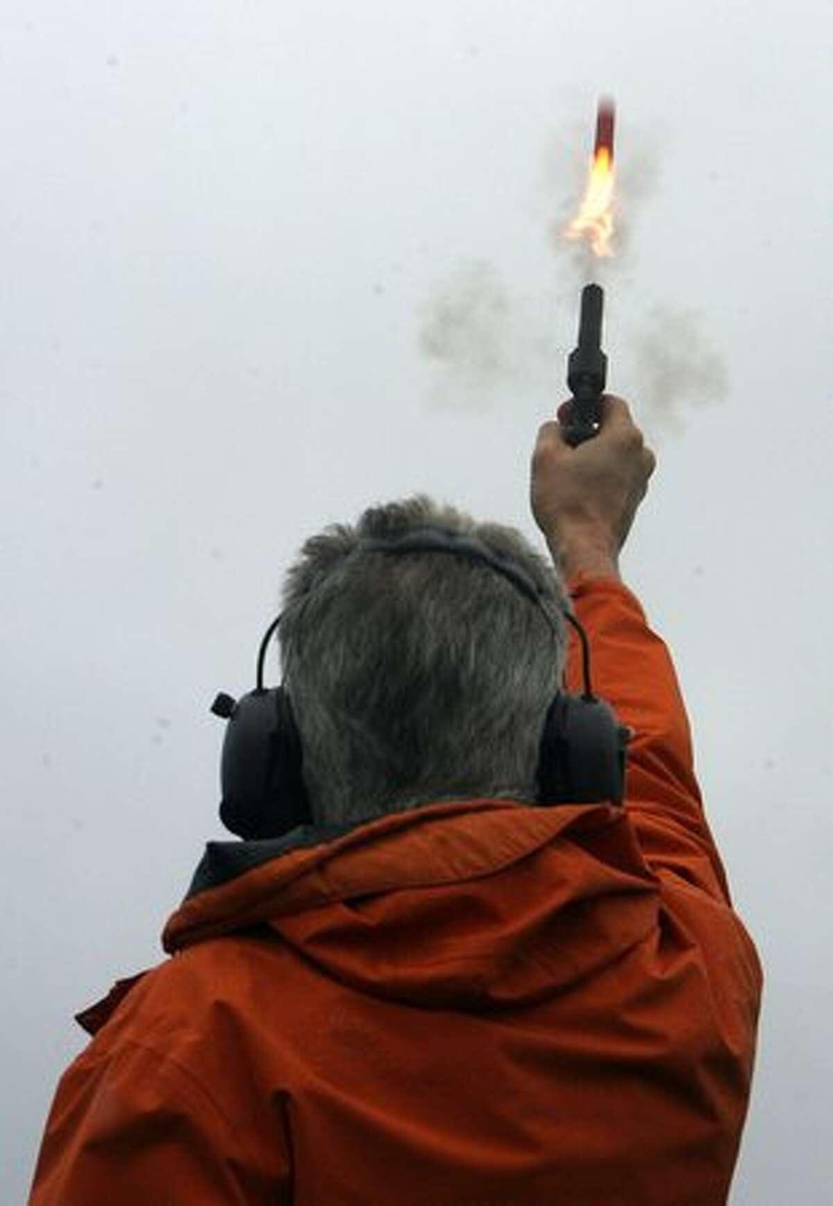 Seattle-Tacoma International Airport Senior Wildlife Biologist/Manager Steve Osmek demonstrates a bird-dispersing sound gun at the airport on Jan. 14, 2009.