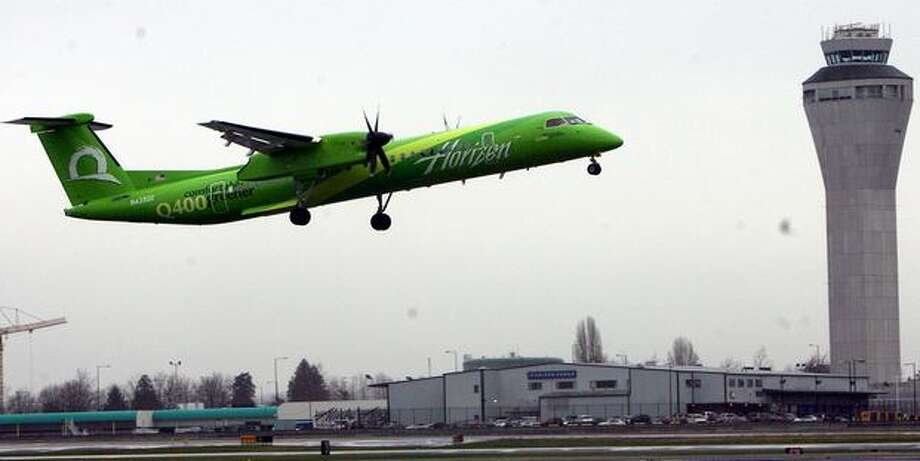 "A Horizon Air Bombardier Q400 in ""Comfortably Greener"" livery. Photo: Aubrey Cohen, Seattlepi.com"