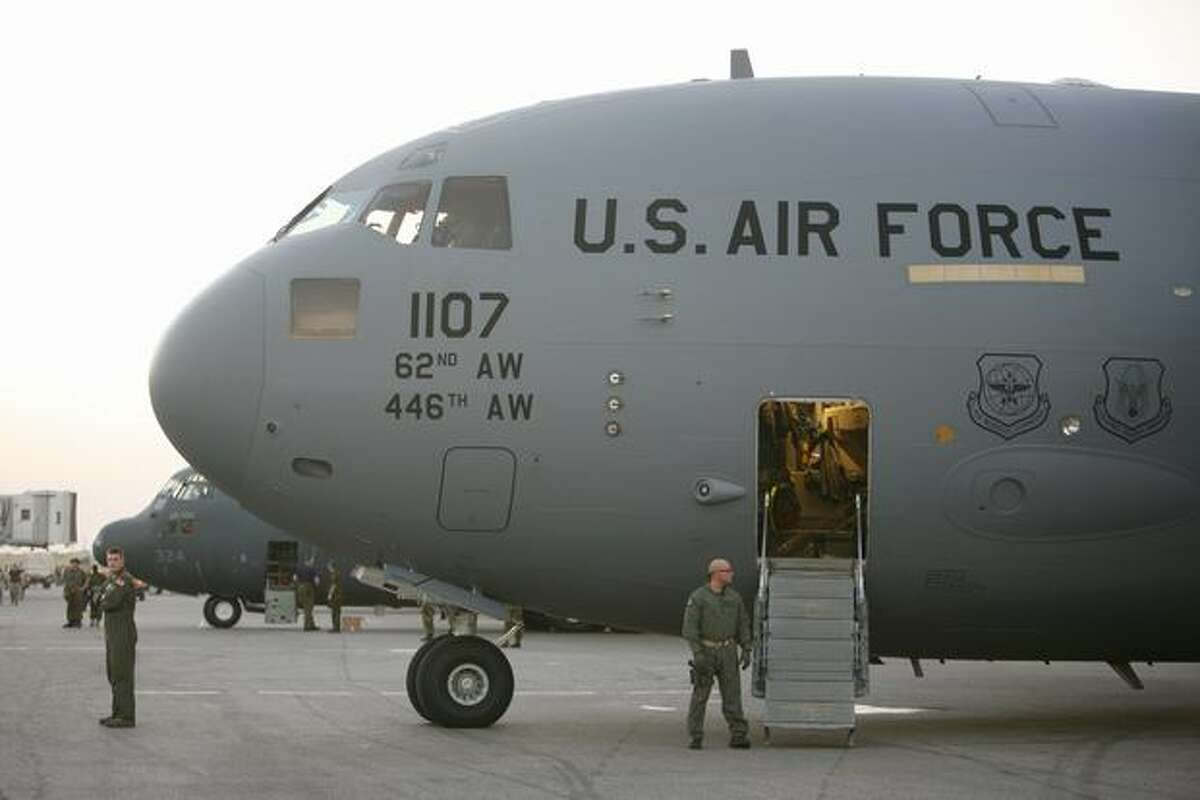 The C-17 Globemaster from McChord Air Force Base sits on the ground at Port-au-Prince, Haiti.