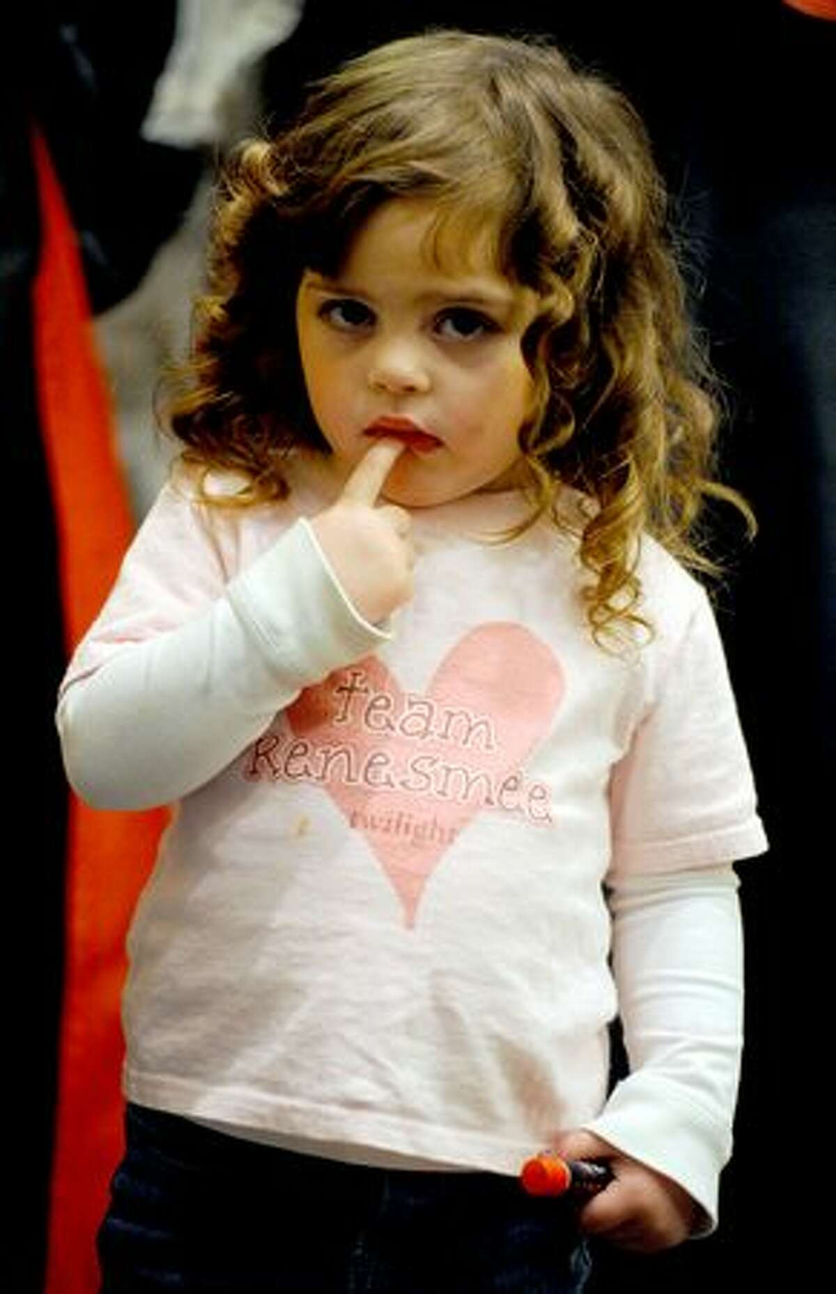 Two-and-a-half-year-old Jadyn Mann waits in line for the costume contest at the Official Twilight Convention at the Westin Hotel in Seattle. She won first place in the junior category.