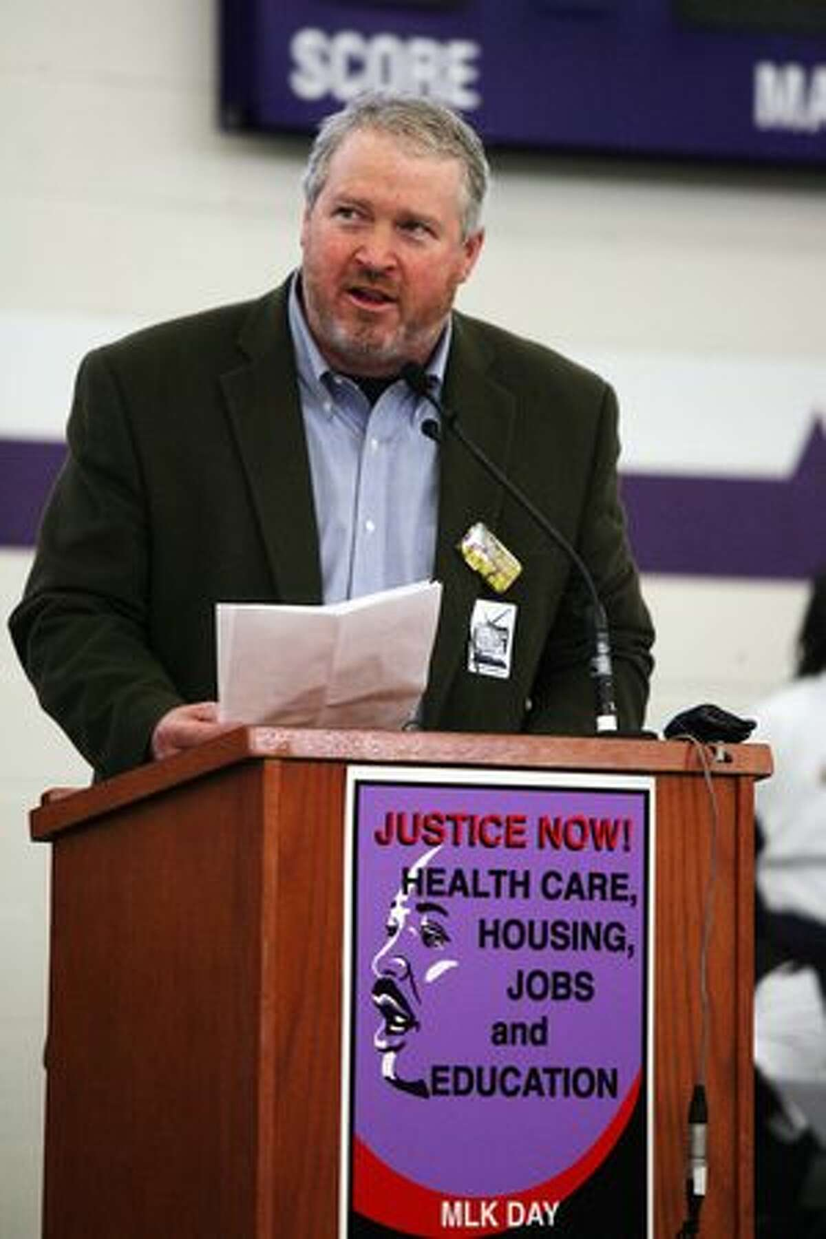 Mayor Mike McGinn speaks to a crowd at Garfield High School on Monday.