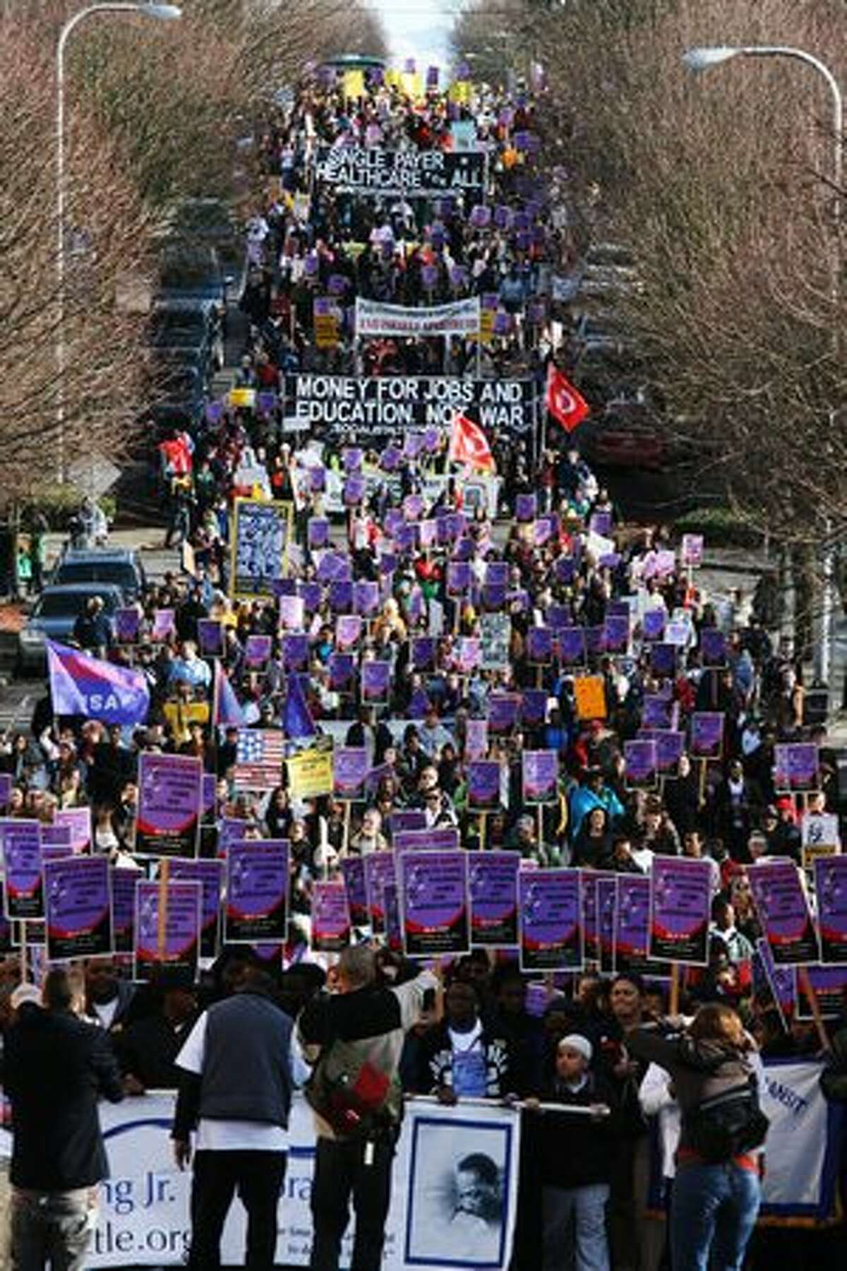 Marchers make their way down East Yesler Way on Monday, Martin Luther King Day.
